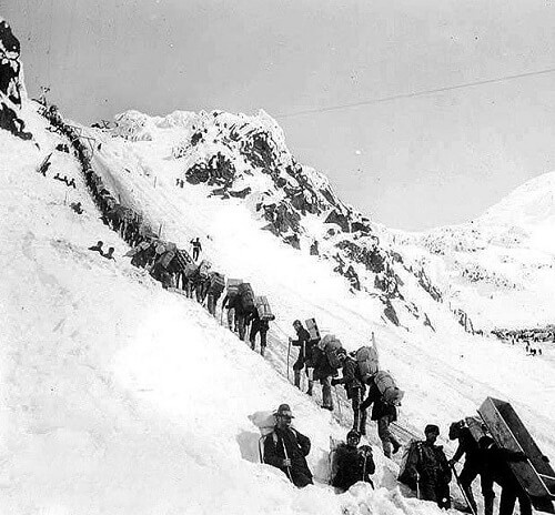 Prospectors travelling up Chilkoot Pass, one of the two popular routes used to reach the Yukon territory.