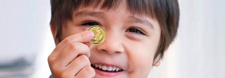 Young boy with a gold coin