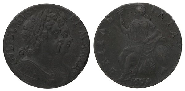 An old copper penny from the reign of William and Mary.