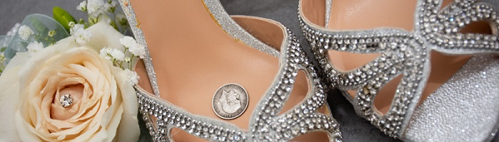 A silver sixpence in a bride's shoe.