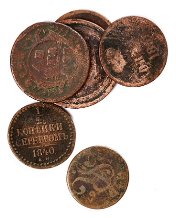 Old coins with tarnishing and scratches.