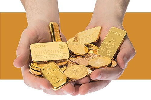 Physical gold bullion in hands.