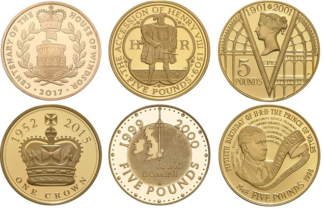 A selection of gold £5 commemorative coins.