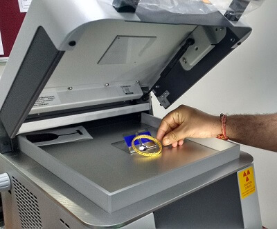 Gold assay machine in use.